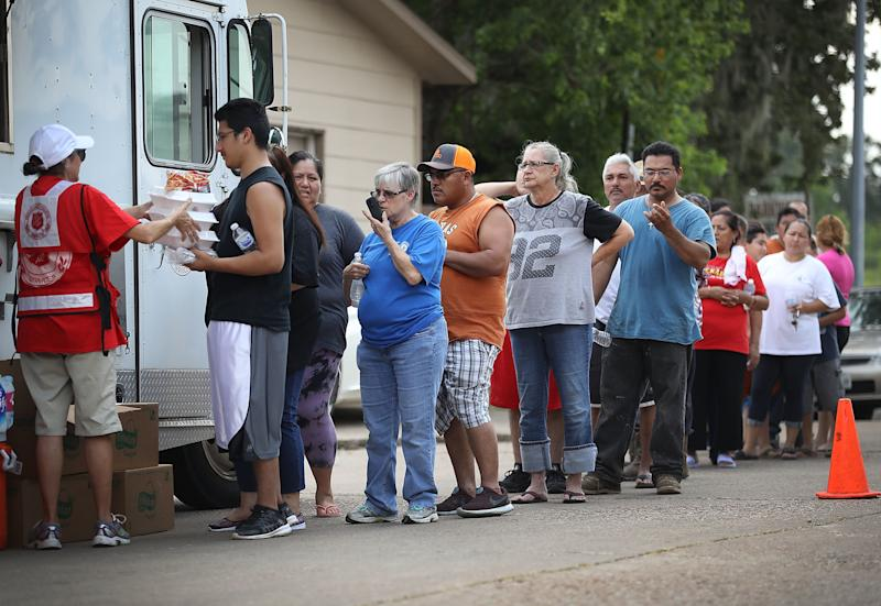 People line up for food and water from the Salvation Army after flooding from Hurricane Harvey in Houston, Sept. 2, 2017. The storm caused more than $125 billion in damage and killed 117 people. (Joe Raedle via Getty Images)