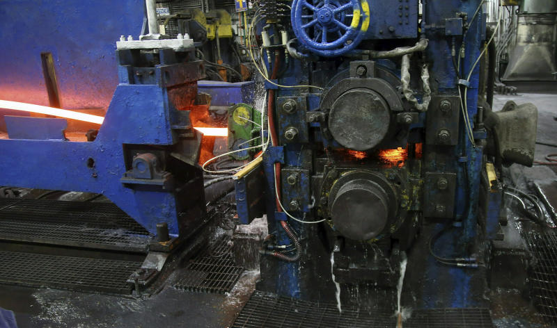 FILE - In this May 9, 2019, file photo, molten steel to make steel rods moves through the production line at the Gerdau Ameristeel mill in St. Paul, Minn. On Friday, June 14, the Federal Reserve reports on U.S. industrial production for April. (AP Photo/Jim Mone, File)