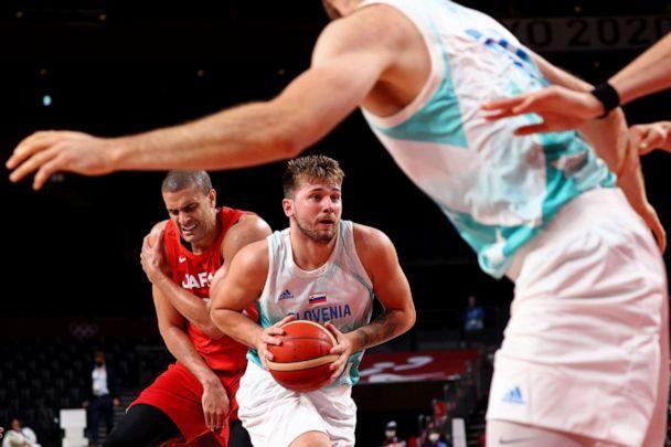 PHOTO: Luka Doncic of Slovenia is seen in action as Gavin Edwards of Japan holds his shoulder after sustaining an injury on July 29, 2021 in Saitama, Japan. (Alkis Konstantinidis/Reuters)