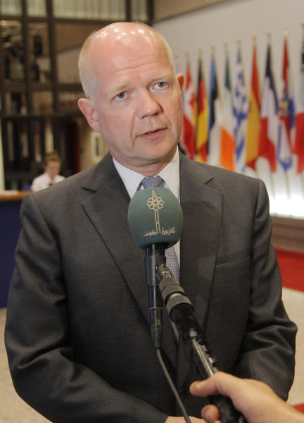 British Foreign Secretary William Hague addresses the media prior to the start of the EU foreign ministers meeting at the European Council building in Brussels, Monday, July 22, 2013. European Union foreign ministers were set Monday to tackle the thorny question of whether Hezbollah's military wing should be blacklisted as a terrorist organization, at a meeting in Brussels that is also due to feature talks on Egypt and Syria. (AP Photo/Yves Logghe)