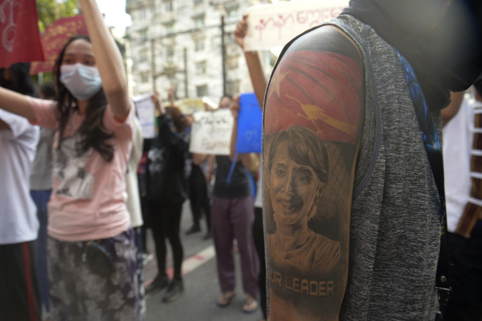 A protester with an image of ousted Myanmar leader Aung San Suu Kyi on the arm joins anti-coup protest march in Yangon, Myanmar, Saturday, April 10, 2021. Security forces in Myanmar cracked down heavily again on anti-coup protesters Friday even as the military downplayed reports of state violence.(AP Photo)