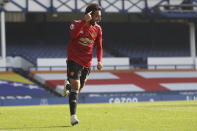 Manchester United's Bruno Fernandes celebrates after scoring his side's opening goal during the English Premier League soccer match between Everton and Manchester United at the Goodison Park stadium in Liverpool, England, Saturday, Nov. 7, 2020. (Carl Recine/Pool via AP)