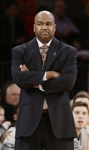 Georgetown head coach John Thompson III watches his team play during the first half of an NCAA college basketball game against the Syracuse at the Big East Conference tournament Friday, March 15, 2013, in New York. (AP Photo/Frank Franklin II)