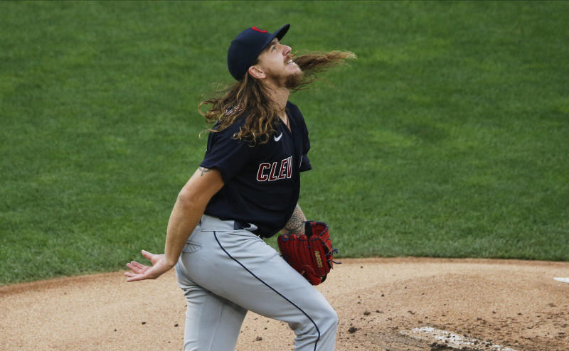 Cleveland Indians' pitcher Mike Clevinger watches the flight of a home run ball off the bat of Minnesota Twins' Eddie Rosario in the first inning of a baseball game Friday, July 31, 2020, in Minneapolis. (AP Photo/Jim Mone)