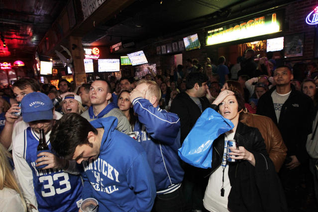 Kentucky fans reacted at Two Keys bar during the NCAA Basketball Men's Championship Game against UConn on Limestone St. in Lexington, Ky., on April 7, 2014. Connecticut defeated the Wildcats 60-54. (AP Photo/The Herald-Leader, Pablo Alcala)
