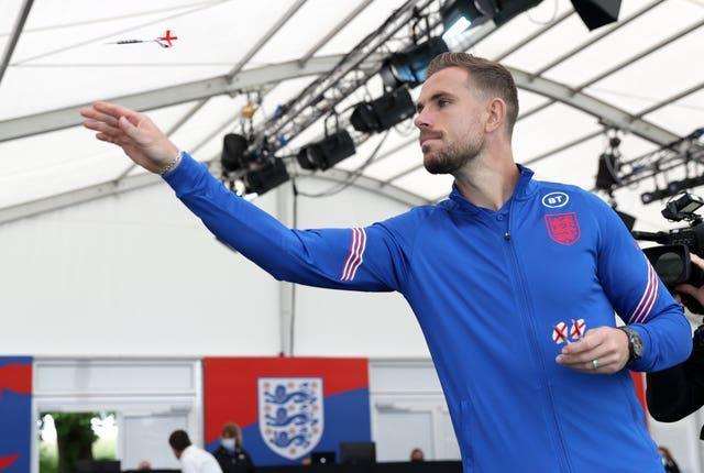 England's Jordan Henderson plays darts after a press conference at St George's Park