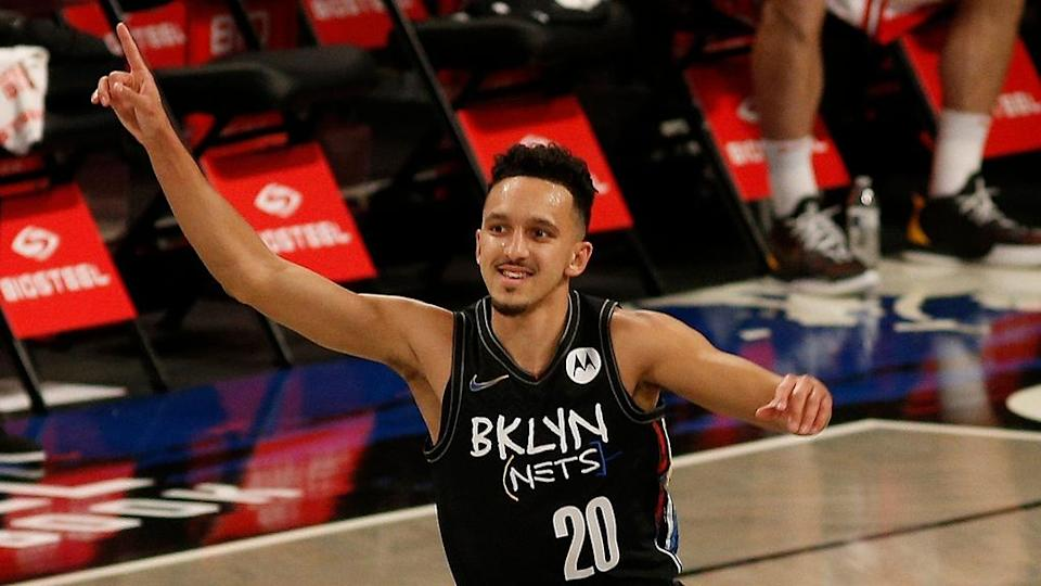 Nets guard Landry Shamet reacts after hitting a three point basket against the Chicago Bulls in 2021