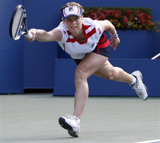 Kim Clijsters of Belgium chases a shot against Laura Robson of Great Britain in the second round of play at the 2012 US Open tennis tournament, Wednesday, Aug. 29, 2012, in New York. (AP Photo/Mel C. Evans)