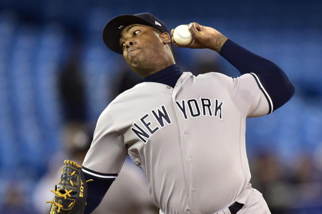 New York Yankees relief pitcher Aroldis Chapman throws to a Toronto Blue Jays batter during the 13th inning of a baseball game Wednesday, June 6, 2018, in Toronto. (Frank Gunn/The Canadian Press via AP)