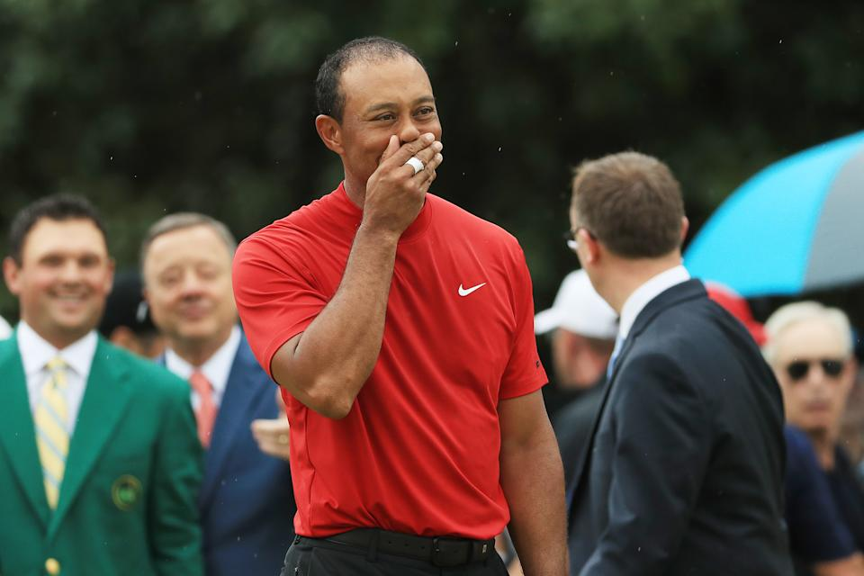 Tiger Woods of the United States reacts during the Green Jacket Ceremony after winning the Masters at Augusta National Golf Club on April 14, 2019 in Augusta, Georgia. (Photo by Mike Ehrmann/Getty Images)