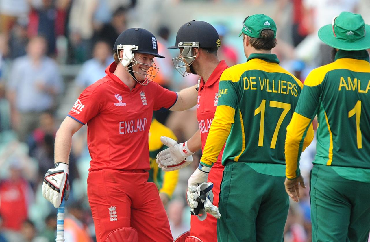 England's Eoin Morgan (left) and Jonathan Trott (centre) celebrate hitting the winning runs during the ICC Champions Trophy, Semi Final at the Oval, London.