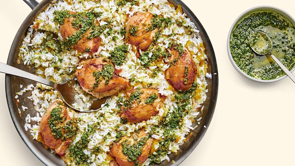 """This one-skillet meal shows what leeks can do for chicken and rice, but it's the deeply savory anchovy-garlic-caper salsa, and the hit of lemon juice before serving that boosts this dish toward lift-off. <a href=""""https://www.epicurious.com/recipes/food/views/chicken-and-rice-with-leeks-and-salsa-verde?mbid=synd_yahoo_rss"""" rel=""""nofollow noopener"""" target=""""_blank"""" data-ylk=""""slk:See recipe."""" class=""""link rapid-noclick-resp"""">See recipe.</a>"""