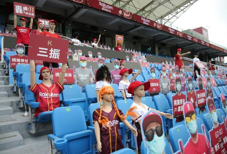 Rakuten Monkeys have unveiled mannequins and robots to sit in the stands (AFP Photo/Alex Lee)