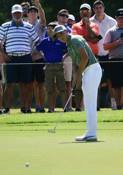 Rickie Fowler misses a putt for birdie on the second hole during the first round of the Tour Championship golf tournament Thursday, Sept. 20, 2018, in Atlanta. (AP Photo/John Amis)
