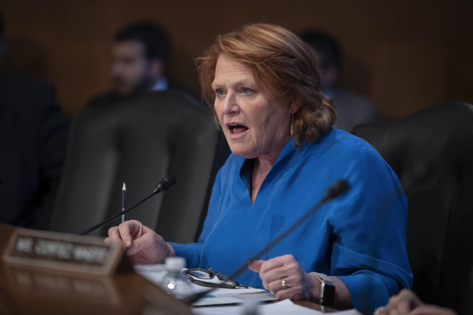 FILE - In this Dec. 12, 2018, file photo, Sen. Heidi Heitkamp, D-N.D., attends her last hearing with the Senate Committee on Indian Affairs as they examine concerns about investigations into the deaths and disappearance of Native American women, on Capitol Hill in Washington. Two Democratic women are contenders to be President-elect Joe Biden's secretary of agriculture. Rep. Marcia Fudge of Ohio and former Sen. Heidi Heitkamp of North Dakota are in the running for the Cabinet position. (AP Photo/J. Scott Applewhite, File)