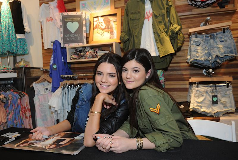 FILE - This Feb. 8, 2013 file photo released by PacSun shows sisters Kendall, left, and Kylie Jenner at the launch their Kendall & Kylie collection on Long Island, N.Y.  Kendall, 17, and Kylie, 15, has teamed up with PacSun to put out clothes aimed at teen girls. (AP Photo/PacSun, Diane Bondareff)