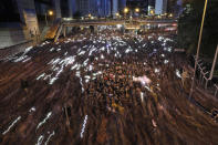 A blur of thousands of protesters march on the streets against an extradition bill in Hong Kong on Sunday, June 16, 2019. Hong Kong residents Sunday continued their massive protest over an unpopular extradition bill that has highlighted the territory's apprehension about relations with mainland China, a week after the crisis brought as many as 1 million into the streets. (AP Photo/Vincent Yu)