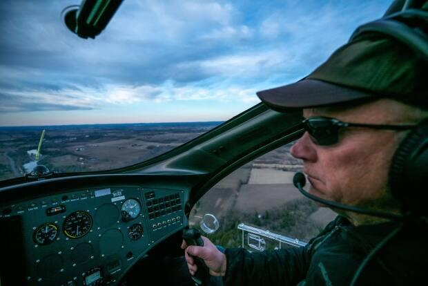 Neil Spriggs, 59, died when he crashed his plane in a wooded area near the Carp Airport in February. (Submitted by Alastair Spriggs - image credit)
