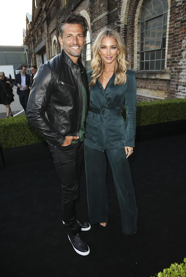 <p>Tim and Anna were all smiles as they posed on the black carpet, Anna wearing a green satin-suit.</p>