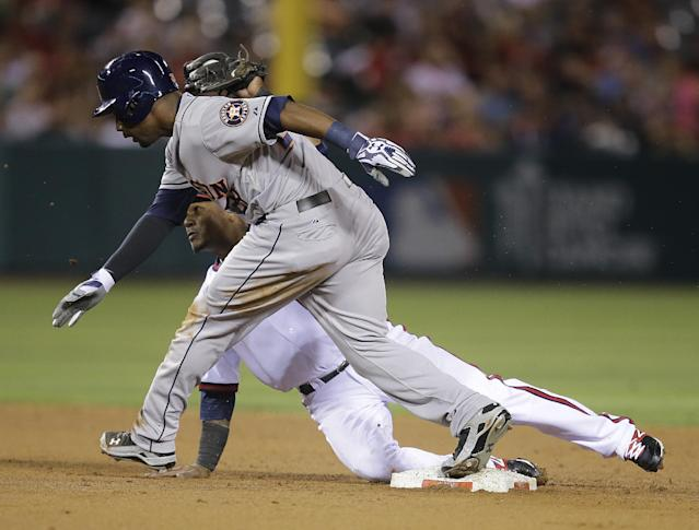 Houston Astros' L.J. Hoes, front, arrives at second base against Los Angeles Angels' Erick Aybar after hitting a double during the fifth inning of a baseball game Friday, Aug. 16, 2013, in Anaheim, Calif. (AP Photo/Jae C. Hong)