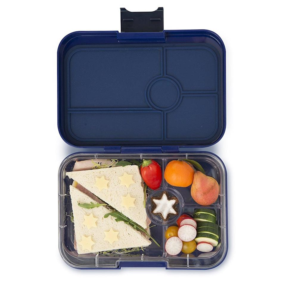 """<p>Bring your lunch to work with the leak-proof Yumbox Tapas lunch container. It's dishwasher-safe and compact enough to fit in your work fridge, yet big enough to hold 4.2 cups of food.</p> <p><a href=""""https://www.popsugar.com/buy/Yumbox-Tapas-lunch-box-579725?p_name=Yumbox%20Tapas%20lunch%20box&retailer=amazon.com&pid=579725&price=33&evar1=fit%3Auk&evar9=44742696&evar98=https%3A%2F%2Fwww.popsugar.com%2Ffitness%2Fphoto-gallery%2F44742696%2Fimage%2F44742700%2FUpgrade-Your-Lunch-Box&list1=holiday%2Cgift%20guide%2Chealthy%20living%2Cfitness%20gifts%2Chealthy%20cooking%20tips%2Chealthy%20eating%20tips%2Cmeal%20prep&prop13=api&pdata=1"""" class=""""link rapid-noclick-resp"""" rel=""""nofollow noopener"""" target=""""_blank"""" data-ylk=""""slk:Yumbox Tapas lunch box"""">Yumbox Tapas lunch box</a> ($33)</p>"""