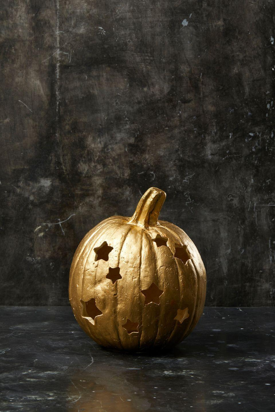 """<p>Even if you can't spot the stars in the sky, this carved pumpkin will give your front stoop a similar starry effect. First, paint the pumpkin the color of your choice and let it fully dry. Then, using a rubber mallet (or a hammer covered with a dishcloth), gently hammer a star-shaped cookie cutter into a real or faux pumpkin until it pushes completely through. Repeat all over the pumpkin until it achieves your desired look. </p><p><a class=""""link rapid-noclick-resp"""" href=""""https://www.amazon.com/Ann-Clark-Cookie-Cutters-Cutter/dp/B00KJ8HLRS?tag=syn-yahoo-20&ascsubtag=%5Bartid%7C10055.g.238%5Bsrc%7Cyahoo-us"""" rel=""""nofollow noopener"""" target=""""_blank"""" data-ylk=""""slk:SHOP COOKIE CUTTERS"""">SHOP COOKIE CUTTERS</a></p>"""