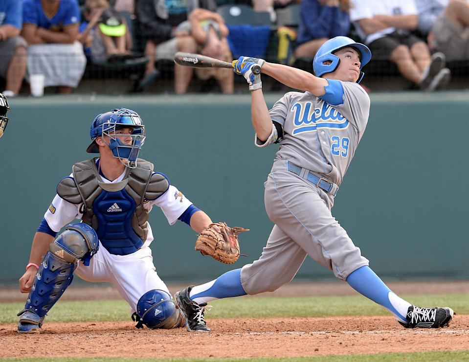 UCLA's Ty Moore watches his two-run home run in the sixth inning, in front of Cal State Bakersfield catcher Logan Trowbridge, during an NCAA college baseball tournament regional game in Los Angeles on Sunday, May 31, 2015. (AP Photo/Jayne Kamin-Oncea)