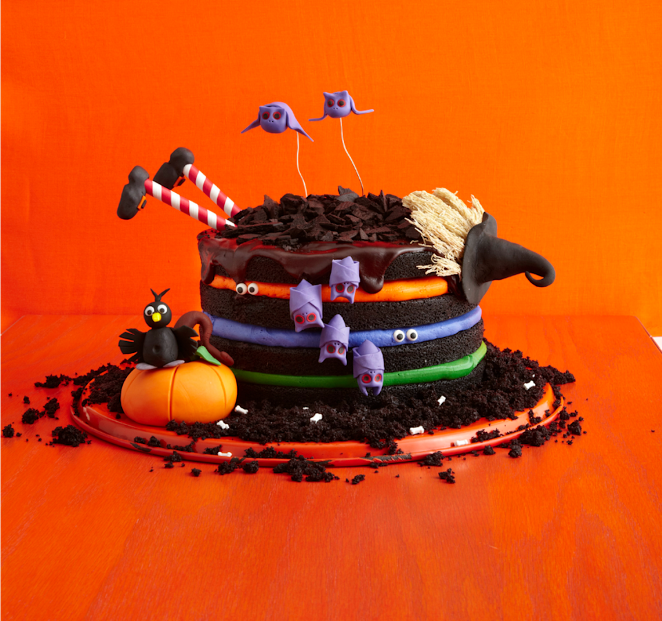 """<p>You don't need a special spell to put together this fun cake —just colorful buttercream and spooky decorations.</p><p><em><a href=""""https://www.womansday.com/food-recipes/food-drinks/recipes/a51843/black-chocolate-cake/"""" rel=""""nofollow noopener"""" target=""""_blank"""" data-ylk=""""slk:Get the recipe from Woman's Day »"""" class=""""link rapid-noclick-resp"""">Get the recipe from Woman's Day »</a></em></p>"""