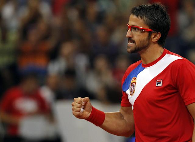 Janko Tipsarevic of Serbia reacts to a winning point during their Davis Cup semifinal tennis match against Milos Raonic of Canada, in Belgrade, Serbia, Friday, Sept. 13, 2013. (AP Photo/Darko Vojinovic)