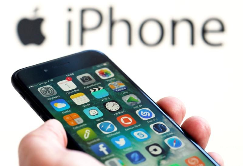 FILE PHOTO: An Apple iPhone 7 and the company logo are seen in this illustration picture taken in Bordeaux