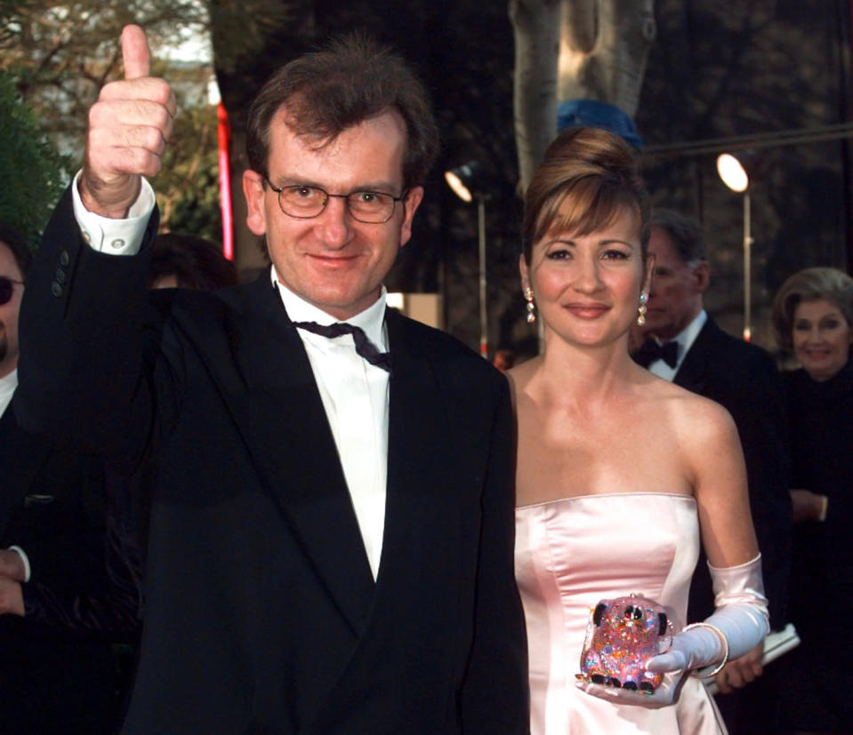 """In this March 25, 1996 photo, Director of """"Babe"""" Chris Noonan, left, and the voice of """"Babe"""" Christine Cavanaugh, right, arrive for the 68th Academy Awards. (AP Photo/Kevork Djansezian, File)"""