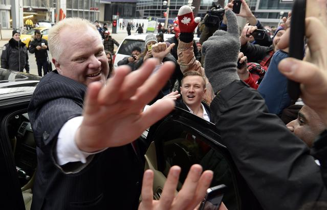 Toronto Mayor Rob Ford celebrates Team Canada's gold medal win over Sweden in the men's ice hockey gold medal game at the Sochi 2014 Winter Olympic Games, in Toronto February 23, 2014. REUTERS/Aaron Harris (CANADA - Tags: POLITICS)