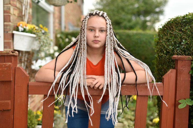 Chenise Benson was sent home from school after showing up with her new box braids, which apparently are a violation of school dress-code policy. (Photo: SWNS)