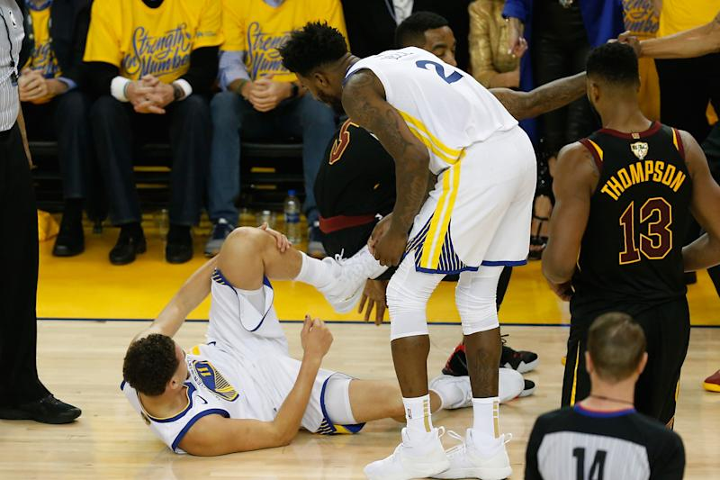 d7c48ffdd1d8 Klay Thompson returns after left leg contusion in collision with J.R. Smith  during Game 1
