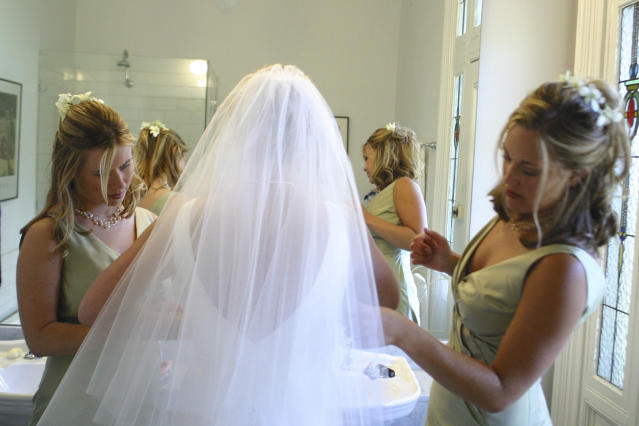 Going to the restroom while wearing a wedding dress is tricky. (Photo: Getty Images)