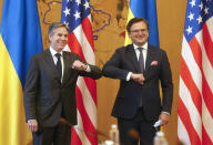 Ukrainian Foreign Minister Dmytro Kuleba, right, and U.S. Secretary of State Antony Blinken, greet each other by touching elbows to curb the spread of COVID-19 ahead of their meeting in Kyiv, Ukraine, Thursday, May 6, 2021. (AP Photo/Efrem Lukatsky, Pool)
