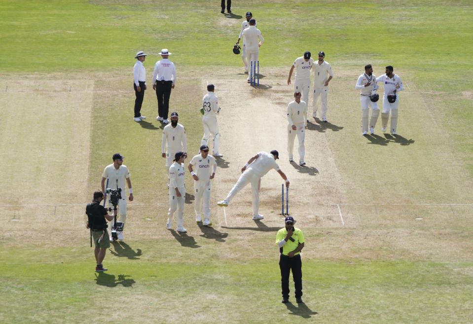 Players leave the field after England won the third test cricket match between England and India, at Headingley cricket ground in Leeds, England, Saturday, Aug. 28, 2021. (AP Photo/Jon Super)