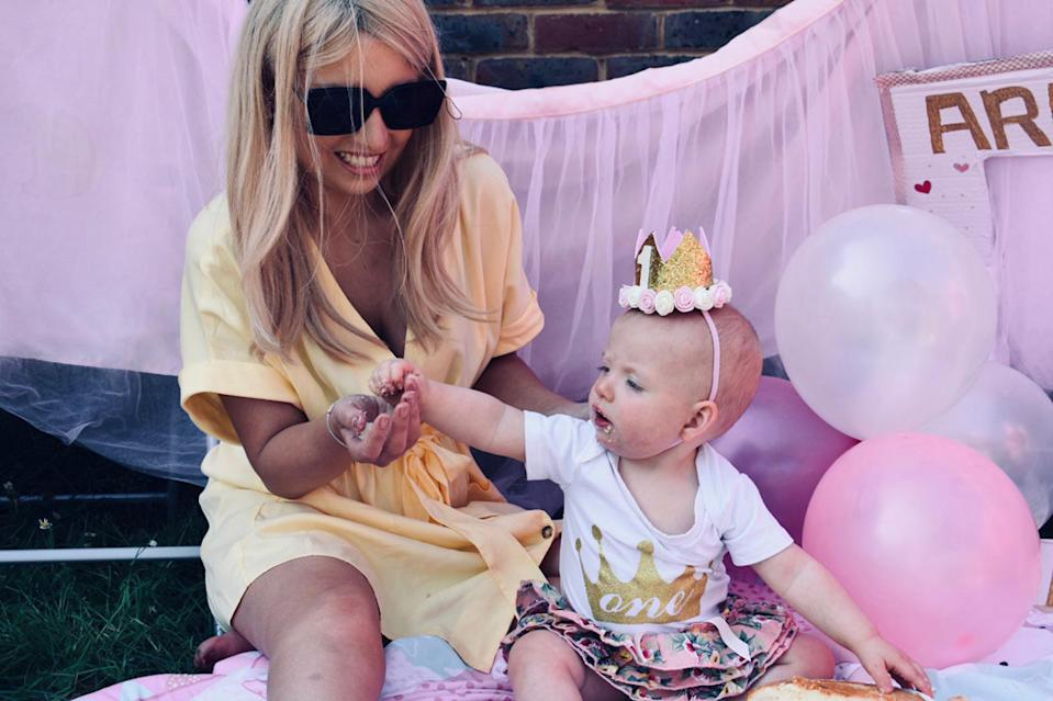 Poppy Stewart-Brown with her daughter Arabella on her first birthday, April 26 2020 (PA Real Life/Collect)