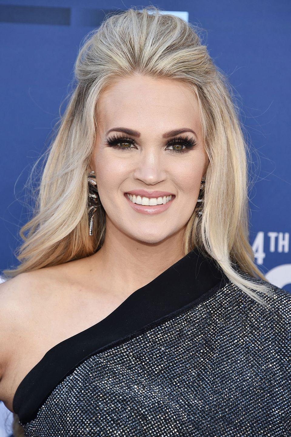 <p>There's a famous expression about hair height, and it rings true with the angelic Carrie Underwood.</p>