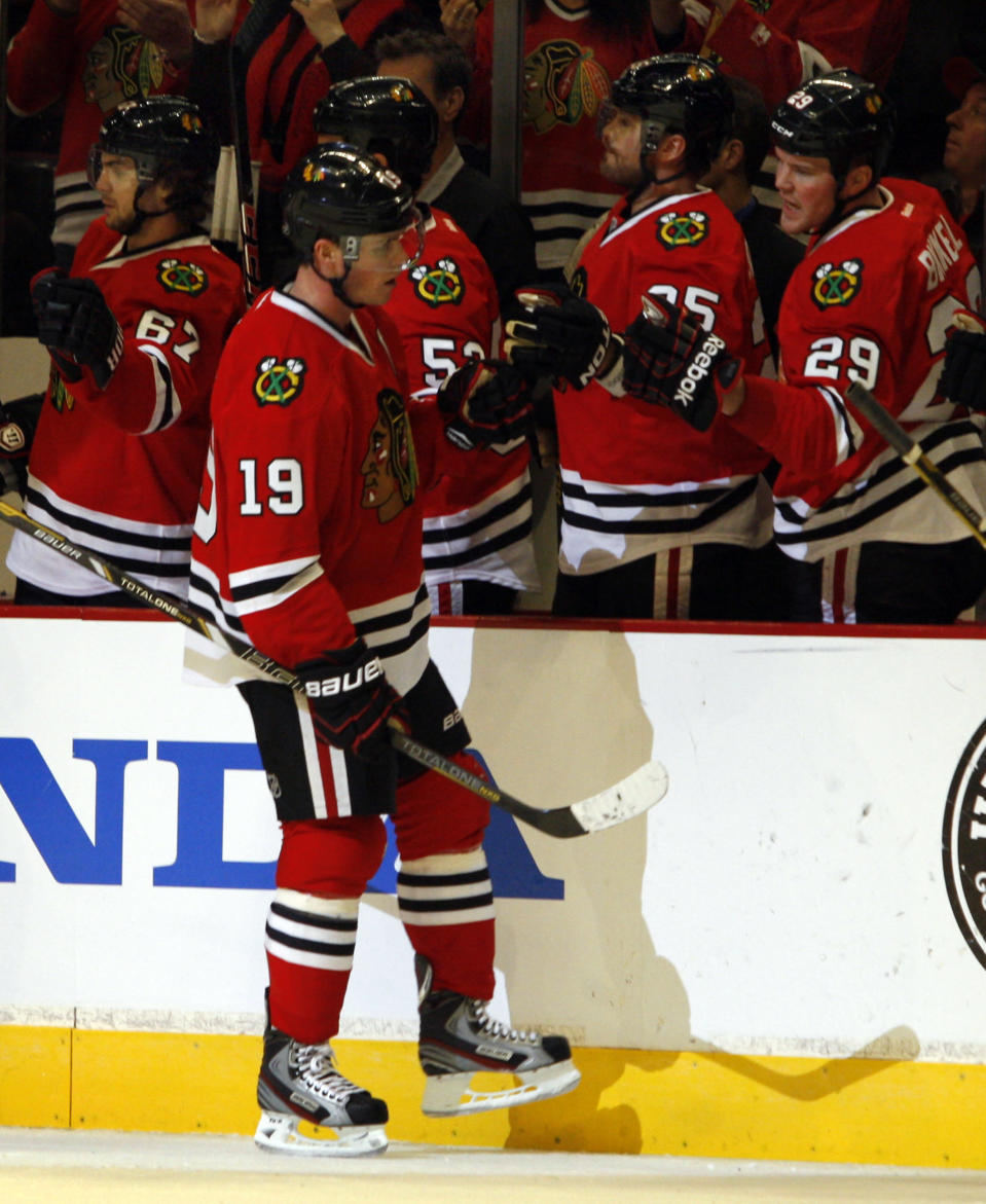 Chicago Blackhawks' Jonathan Toews (19) is congratulated by teammates after scoring the second Blackhawks goal against the Los Angeles Kings during an NHL hockey game on Sunday, Feb. 17, 2013, in Chicago. (AP Photo/John Smierciak)