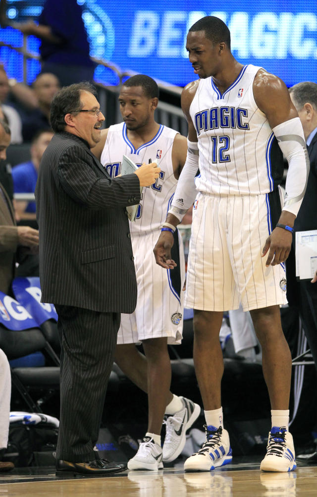 Orlando Magic coach Stan Van Gundy, left, talks with Dwight Howard (12) during a timeout in the first half of an NBA basketball game against the New York Knicks, Thursday, April 5, 2012, in Orlando, Fla. (AP Photo/John Raoux)