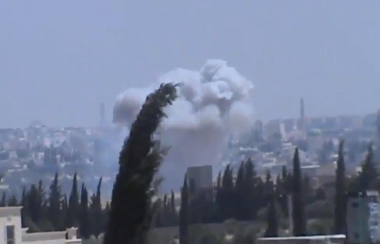 In this image taken from video obtained from the Shaam News Network, which has been authenticated based on its contents and other AP reporting, columns of smoke billowing as a result of heavy bombing, in the countryside outside of Aleppo Syria, Monday July 22, 2013. Syrian rebels seized a strategic village on the edge of the northern city of Aleppo on Monday, activists said, just hours after other opposition fighters sustained some of their heaviest losses in months in battles to the south near the capital, Damascus. (AP Photo/Shaam News Network via AP video)