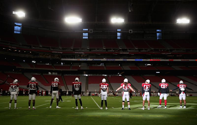 The Arizona Cardinals warm-up during a training camp practice at University of Phoenix Stadium. (Photo by Christian Petersen/Getty Images)