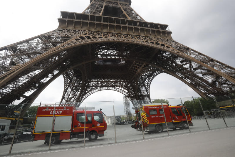 Eiffel Tower locked down amid reports man climbs landmark