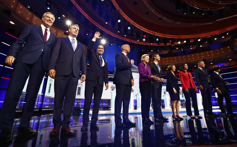 From left, New York City Mayor Bill de Blasio, Rep. Tim Ryan, D-Ohio, former Housing and Urban Development Secretary Julian Castro, Sen. Cory Booker, D-N.J., Sen. Elizabeth Warren, D-Mass., former Texas Rep. Beto O'Rourke, Sen. Amy Klobuchar, D-Minn., Rep. Tulsi Gabbard, D-Hawaii, Washington Gov. Jay Inslee, and former Maryland Rep. John Delaney pose for a photo on stage before the start of a Democratic primary debate hosted by NBC News at the Adrienne Arsht Center for the Performing Arts, Wednesday, June 26, 2019, in Miami. (Photo: Brynn Anderson/AP)