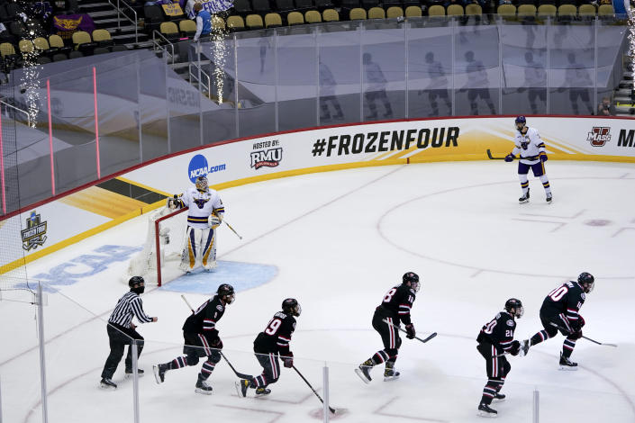 The St. Cloud State team follows Kyler Kupka (10) off the ice after he scored on Minnesota State goaltender Dryden McKay (29) during the first period of an NCAA hockey semifinal game at the Frozen Four in Pittsburgh, Thursday, April 8, 2021. (AP Photo/Keith Srakocic)