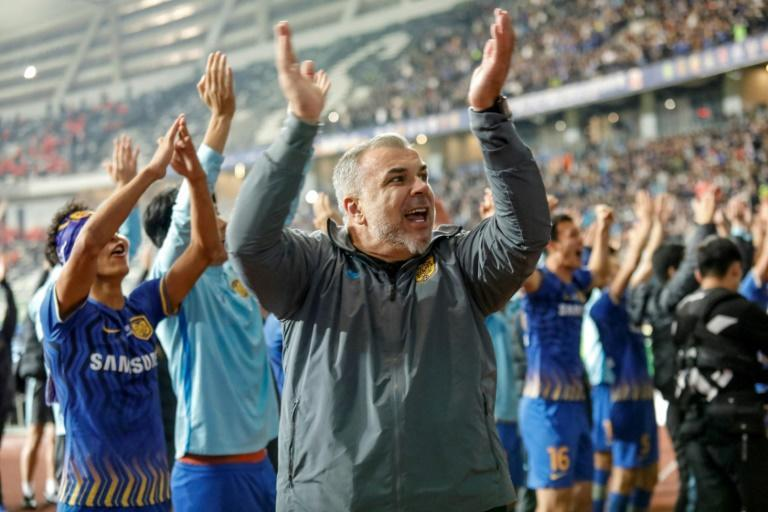 Jiangsu Suning's head coach Cosmin Olaroiu (C) quit the club earlier this month, reports in China and Romania say
