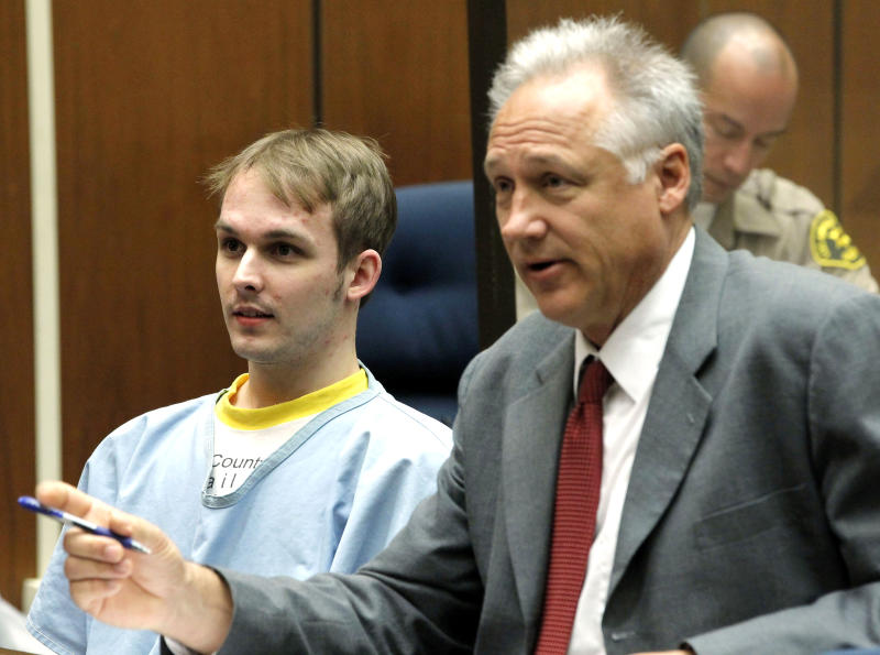 """Nicholas Prugo, left, is seen with his attorney Markus Dombois at the Criminal Courts Building in Los Angeles on Monday, April 15,2013. A judge has sentenced Prugo the alleged ringleader of the group that burglarized celebrities' homes to time served. Prugo is the final defendant in the so-called """"Bling Ring"""" to be sentenced. He pleaded no contest in March 2012 to stealing from Lindsay Lohan and reality star Audrina Patridge in exchange for a two year prison sentence. (AP Photo/Nick Ut)"""