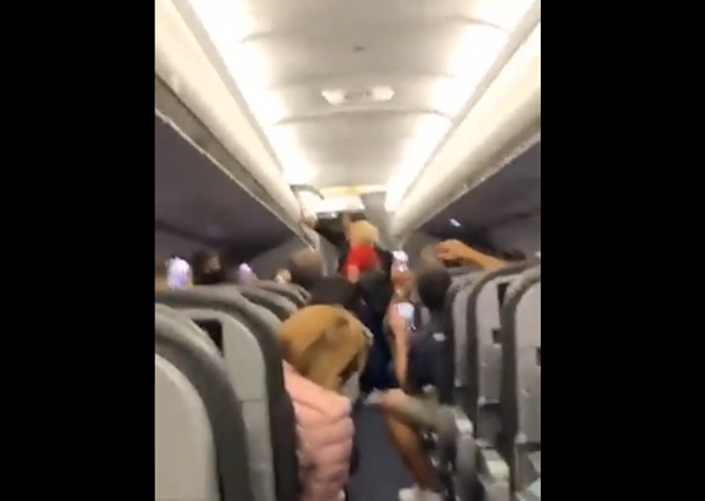 Shaky footage shows fellow passengers breaking out in song (@dreatrev/Instagram)
