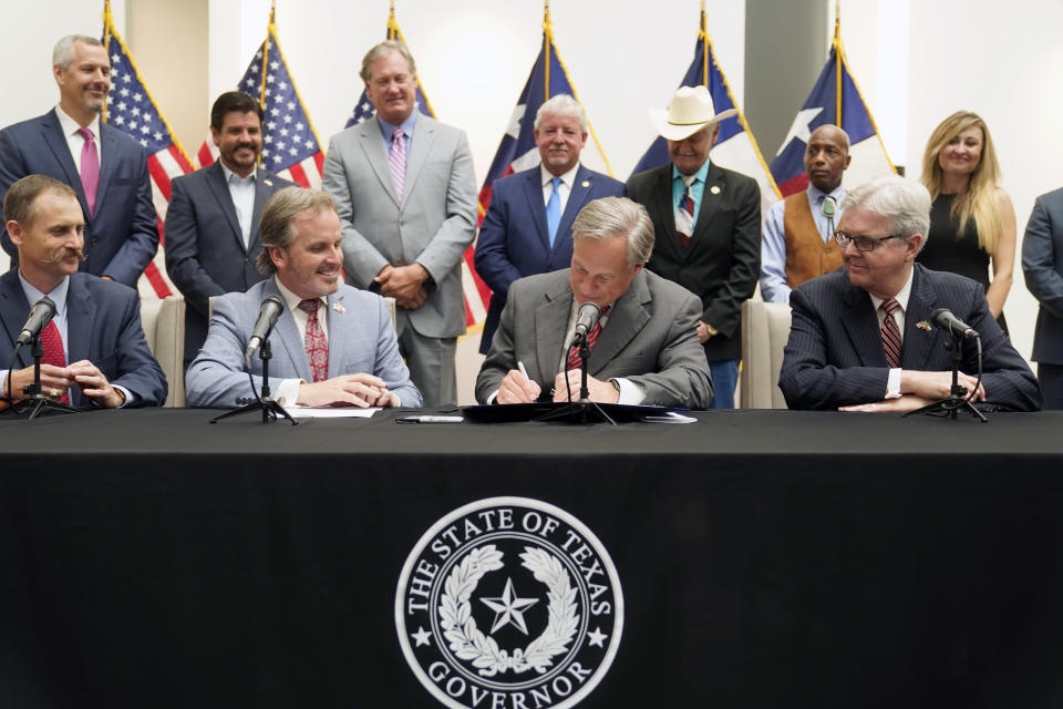 WATCHTexas Governor Greg Abbott Signs Republican-backed Restrictive Voting Bill Into Law